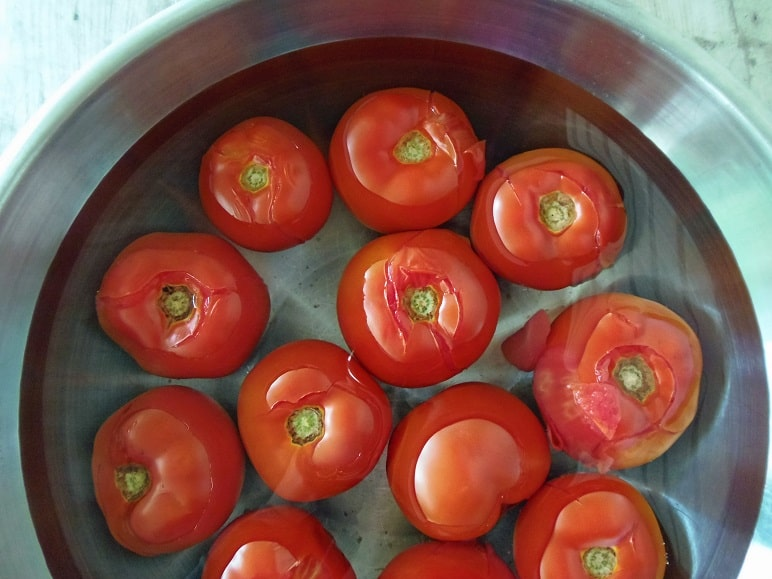 Tomatoes Cooling in Ice Water