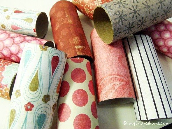 Wrap the Toilet Paper Rolls in Scrapbook Paper