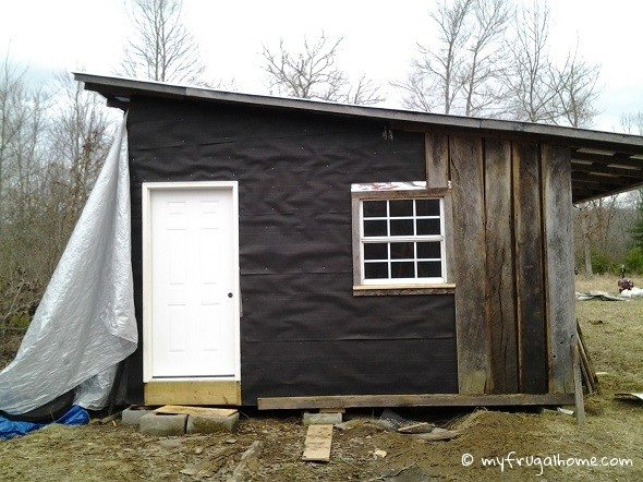 Side of Cabin Being Sided