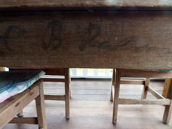 Writing on Side of Farm Table