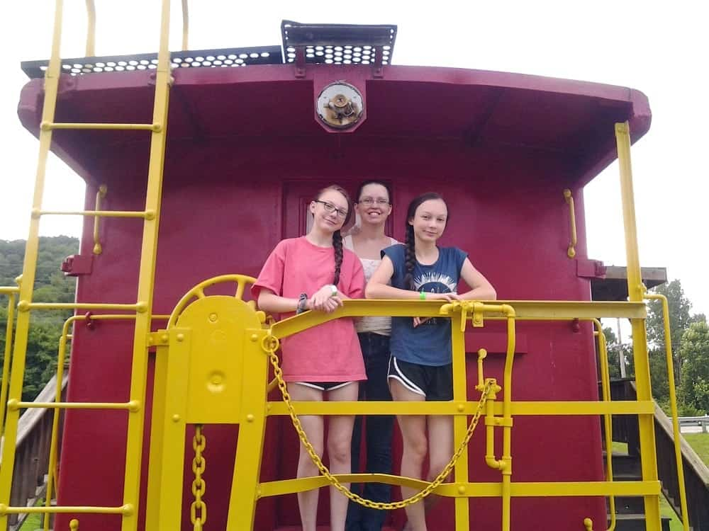 Family Photo on the Back of a Caboose