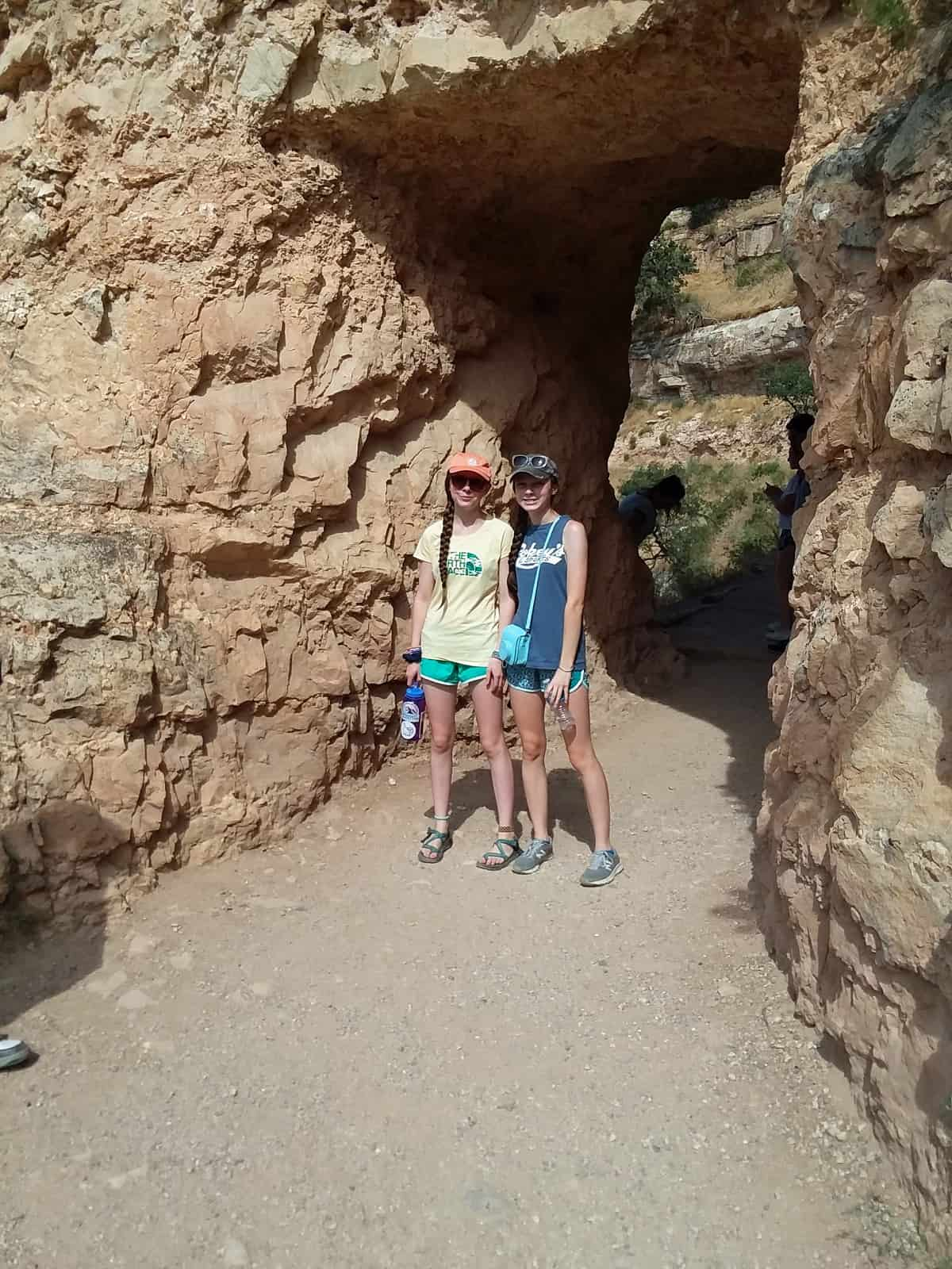 Girls Standing in Front of Tunnel on Bright Angel Trail