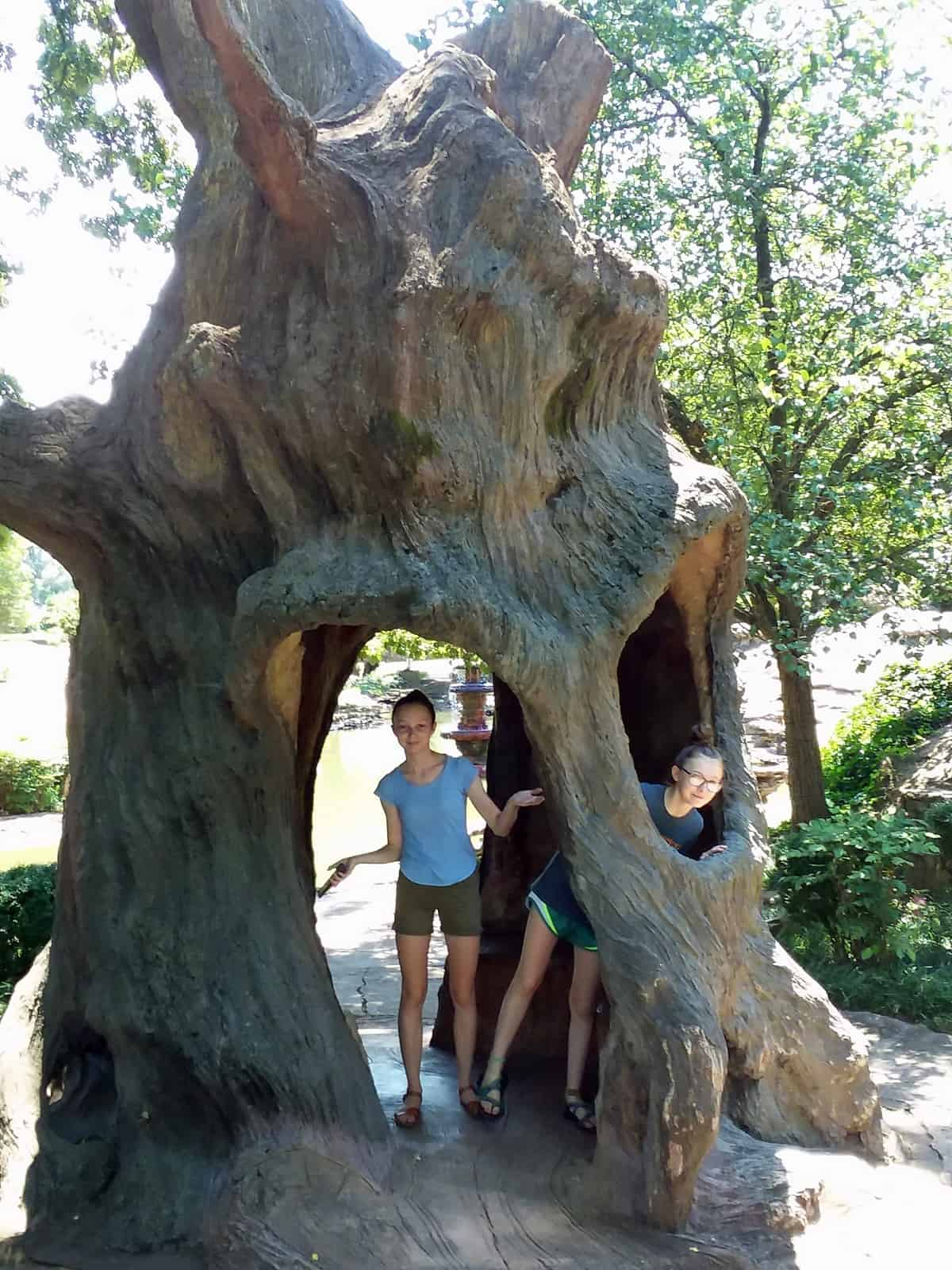 Girls Standing inside Faux Bois Tree