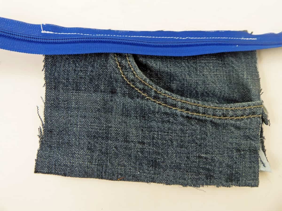 Sew the Zipper to the Top of the Pocket