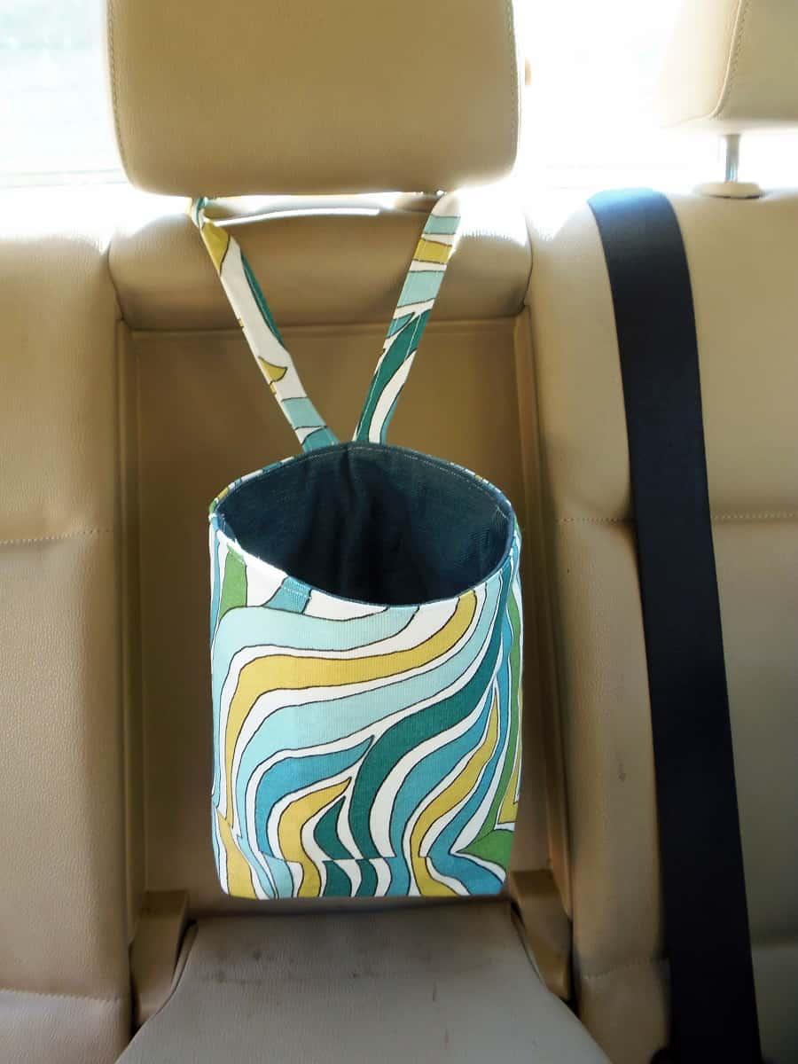 Car Trash Bag Hanging From Center Headrest in Back Seat