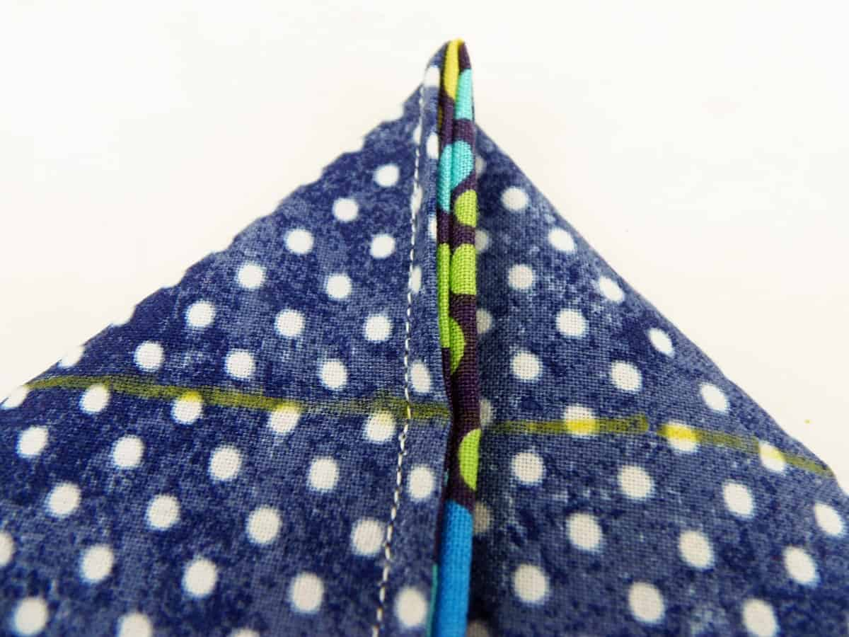 Flatten Bottom of Side Seams to Form Triangle
