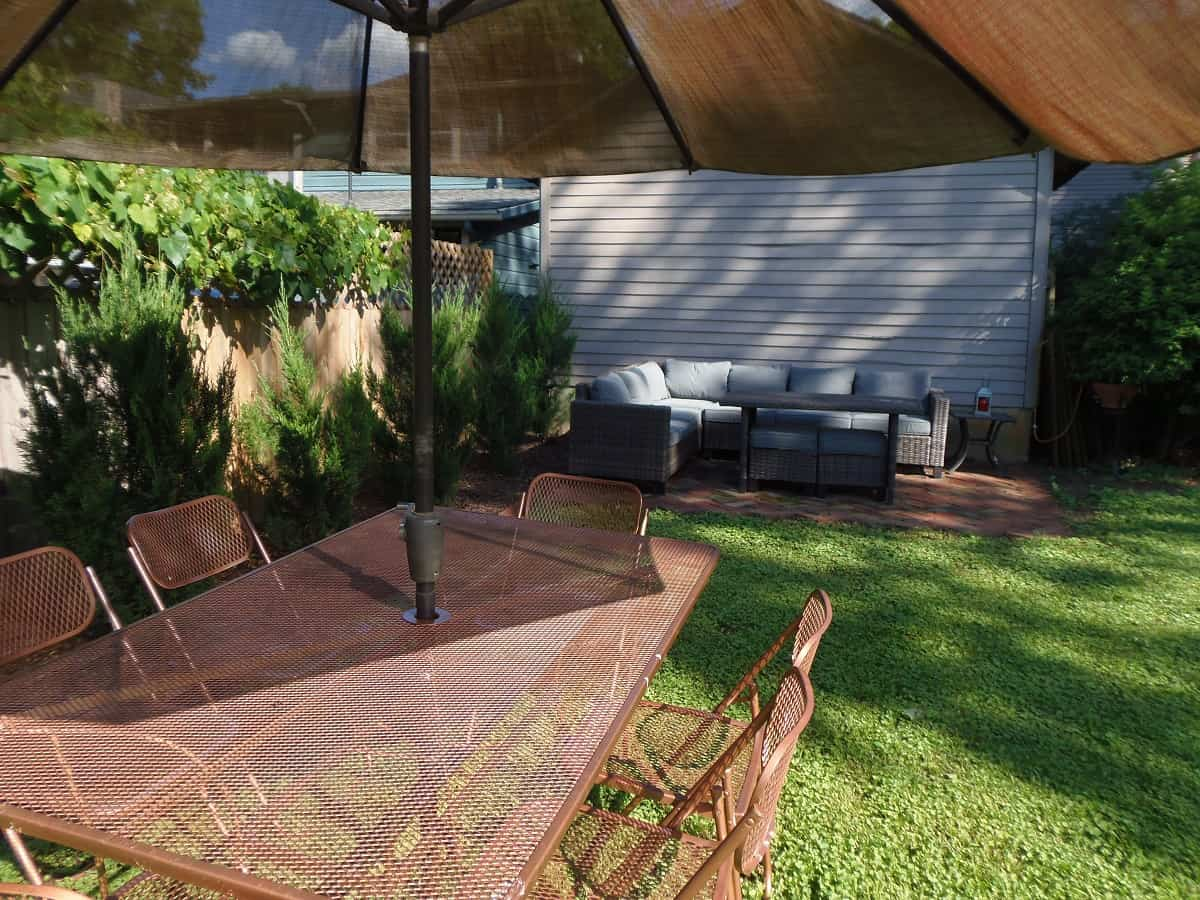 Brick Patio With Sectional and Patio Table
