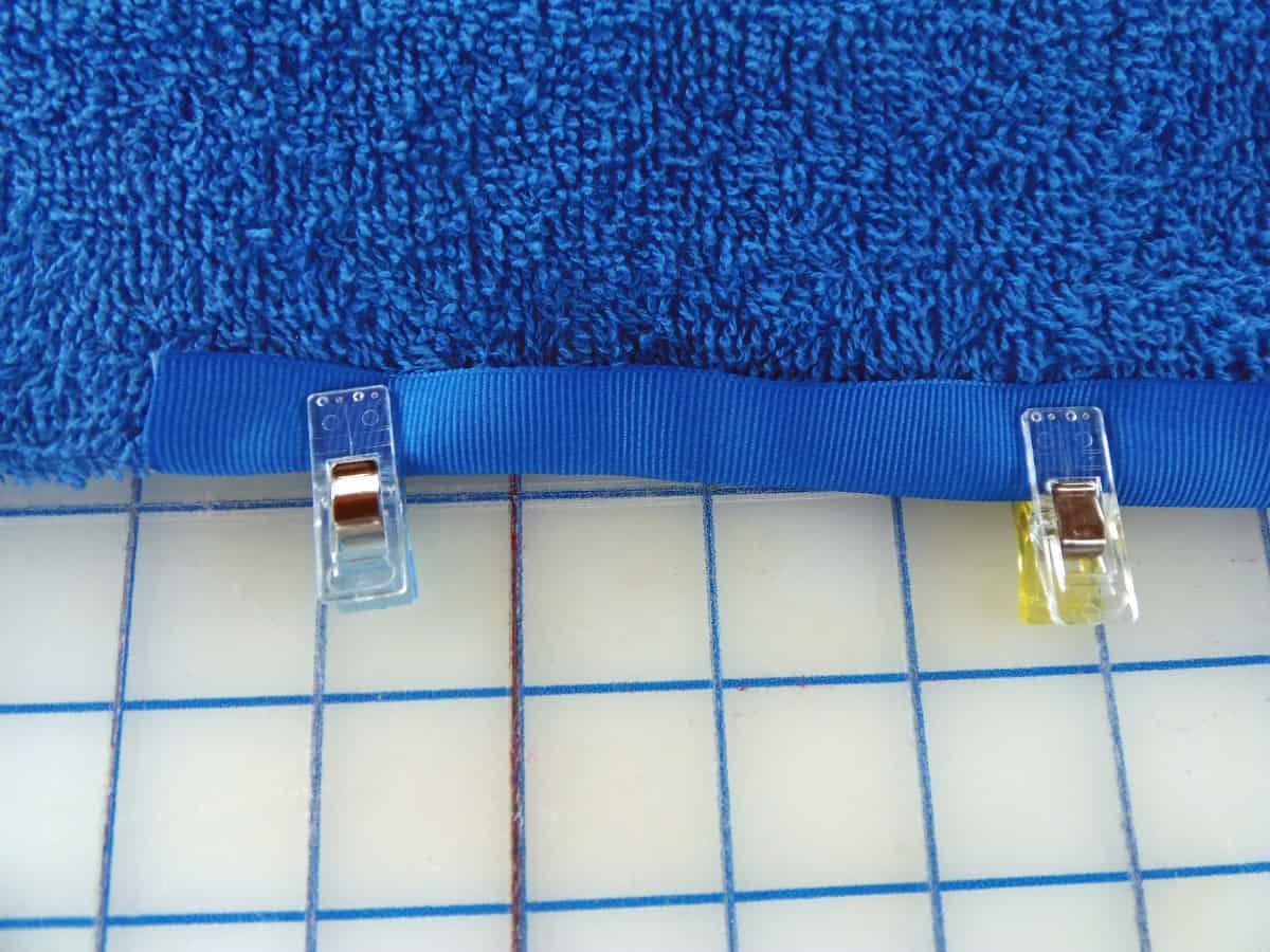 Overlap Edge of Bath Mat With Ribbon